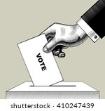 hand putting voting paper in... | Shutterstock .eps vector #410247439