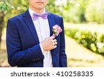 groom in the wedding suit | Shutterstock . vector #410258335