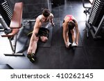 a young couple stretching in... | Shutterstock . vector #410262145