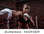 young woman in boxing ring | Shutterstock . vector #410291839