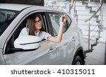 young happy woman near the car... | Shutterstock . vector #410315011