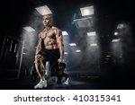 muscular bodybuilder doing... | Shutterstock . vector #410315341