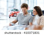 beautiful young couple looking... | Shutterstock . vector #410371831