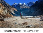 hiker in himalayas mountain.... | Shutterstock . vector #410391649