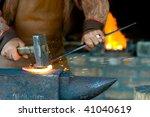 A Blacksmith Forging A...