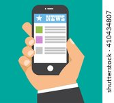 news app on smartphone screen....