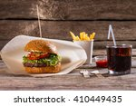 burger with fries and cola....   Shutterstock . vector #410449435