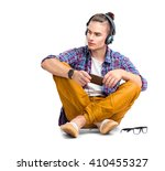 young fashion man sitting on...   Shutterstock . vector #410455327