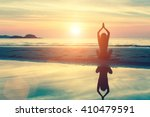 silhouette woman yoga on the... | Shutterstock . vector #410479591