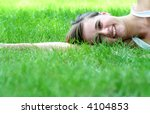 woman lying on grass  smiling | Shutterstock . vector #4104853
