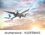 Aeroplane Flying In Sunset Sky...