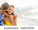 outdoor portrait of cute small... | Shutterstock . vector #410573539