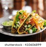 vegetarian lentil tacos on plate   Shutterstock . vector #410606899