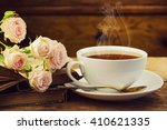 a cup of tea and roses. vintage ... | Shutterstock . vector #410621335