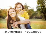 daughter mother adorable... | Shutterstock . vector #410628979