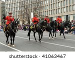 TORONTO-NOVEMBER 15: The Canadian Royal Mounted Police traditionally participate at the 105 annual Toronto Santa Close Parade on November 15, 2009 in Toronto, Canada. - stock photo