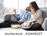 young couple watching tv on a... | Shutterstock . vector #410648107