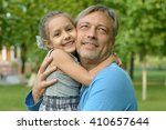 father with daughter in summer... | Shutterstock . vector #410657644