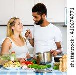 positive black husband helping... | Shutterstock . vector #410674771