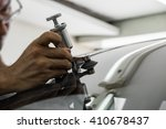 mechanic using repairing... | Shutterstock . vector #410678437