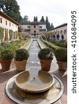 Small photo of Granada, Spain - 9 December,2015 : Patio de la Acequia (Court of the Water Channel) with water fountain and beautiful garden, Granada, Spain on 9 December 2015 in Granada, Spain