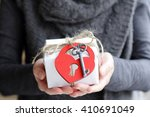 warm background with a gift and ... | Shutterstock . vector #410691049