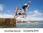 group of teenagers jumping off... | Shutterstock . vector #410696599