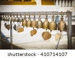 many golden buddhist bells with ... | Shutterstock . vector #410714107