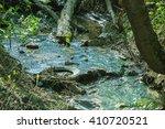 garbage in spring steam.... | Shutterstock . vector #410720521