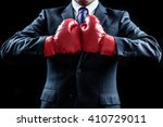 Stock photo businessman boxing gloves fighting pose 410729011