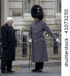 Small photo of WHITEHALL, LONDON - NOV 8: The parade sergeant major instructs a city Alderman to his position at the Royal British Legion Remembrance Parade at the Cenotaph November 8, 2009 in Whitehall, London.