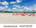 summer beach with sun umbrellas ... | Shutterstock . vector #410732929