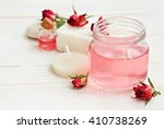 Stock photo delicate pink rose attar in jar dried flowers candle relaxing aromatherapy soft focus soft 410738269