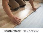 installation of floating floors ... | Shutterstock . vector #410771917