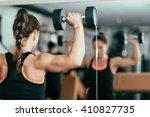 young woman doing shoulder... | Shutterstock . vector #410827735