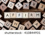 Small photo of the word of AFFIRM on building blocks concept
