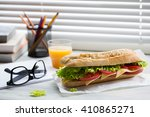 sandwich from fresh baguette... | Shutterstock . vector #410865271
