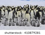Stock photo emperor penguins with chick 410879281