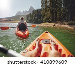 couple canoeing in the lake on... | Shutterstock . vector #410899609