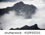 hills and fog on madeira island ... | Shutterstock . vector #410935231