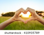 Hand Shaped Heart Against A...