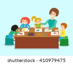 kindergarten teacher woman... | Shutterstock .eps vector #410979475