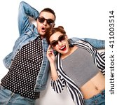 fashion couple in sunglasses... | Shutterstock . vector #411003514