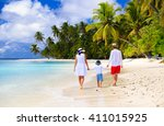 family with child walking on... | Shutterstock . vector #411015925