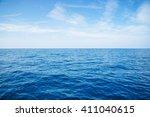 empty blue ocean and blue sky | Shutterstock . vector #411040615