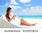 Woman Using Phone App Relaxing...