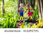 children play with colorful... | Shutterstock . vector #411092791