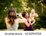 mother taking photo of... | Shutterstock . vector #411094534