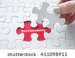 close up of girl's hand placing ...   Shutterstock . vector #411098911