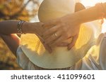 woman with hat relaxing... | Shutterstock . vector #411099601